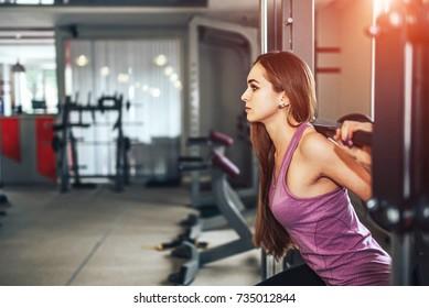 Pretty sporty girl training in the gym