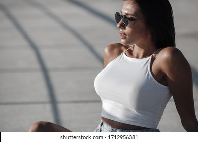 pretty sporty woman outdoors. woman in top. girl's summer portrait
