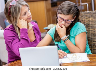 pretty student girl taking courses with beautiful blond teacher