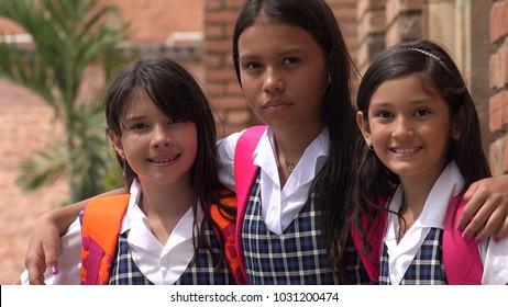 Pretty Students Wearing School Uniforms