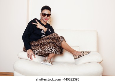 pretty stylish african american big mama woman well dressed. swag relax at home, leopard print on clothers. fashion lookpretty stylish african american big mama woman well dressed. swag relax at home