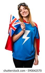 Pretty superhero girl holding an United Kingdom flag