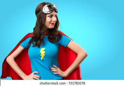 Pretty superhero girl looking lateral on colorful background