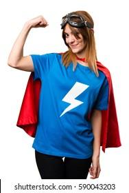 Pretty superhero girl making strong gesture