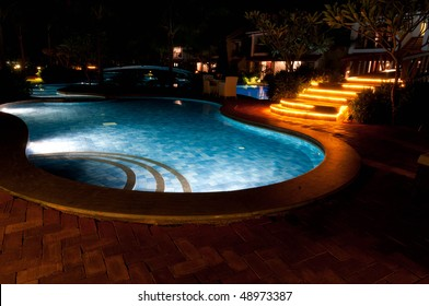 A pretty swimming pool in night at a local resort