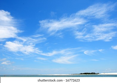 Pretty swirling cirrus clouds over ocean