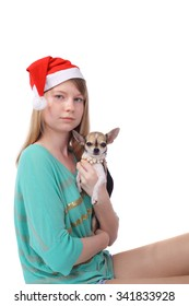 pretty teen Christmas girl with the little dog