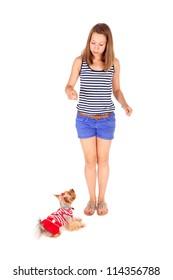 pretty teen girl feeding cute little dog