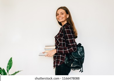 Pretty teen girl isolated student of school or college with stack of books