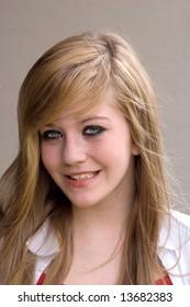 Pretty teen girl smiling brightly