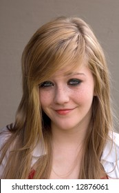 Pretty teen girl smiling (sorta)