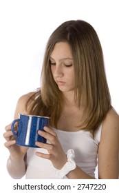 pretty teen inspecting mug