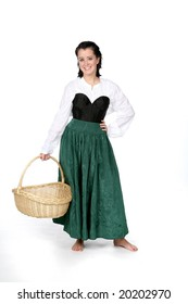 pretty teenage girl in green and black dress holding a basket