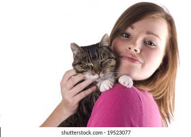 Pretty teenage girl holding her cat, isolated on a white background.