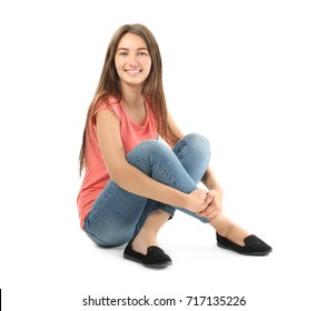 Pretty teenage girl posing on white background