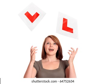 Pretty teenage girl throwing away her L-plates after passing her driving test