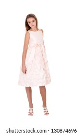 Pretty teenage girl in a white dress on a white background