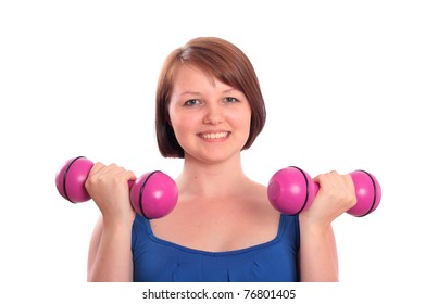 Pretty teenager exercising with dumbbells