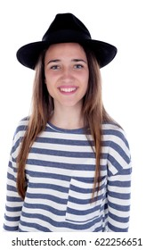 Pretty teenager girl with black hat posing at studio. Isolated over white background.