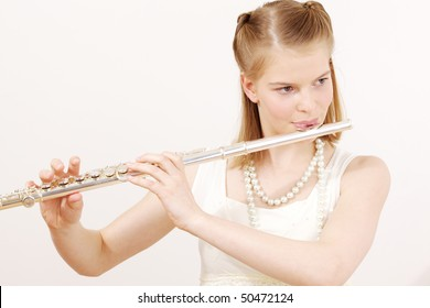 pretty teenager girl playing the flute