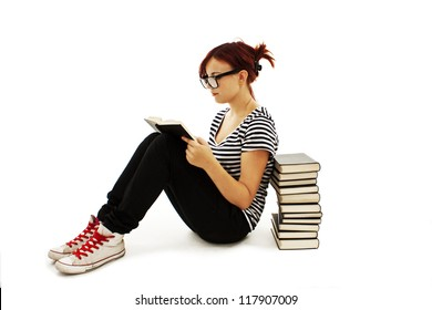 Pretty teenager girl sit on floor and reading book.  on white background