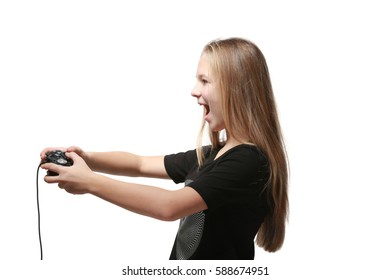 Pretty teenager playing videogame on white background