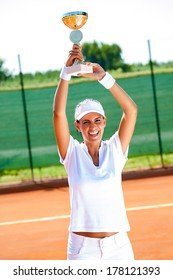 Pretty tennis player won the cup at the sport competition, victory