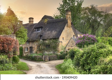Pretty thatched Cotswold cottage in the village of Stanton, Gloucestershire, England.