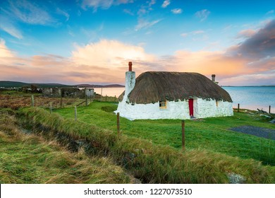 A pretty thatched cottagemat Malaclate on North Uist in the Western Isles of Scotland