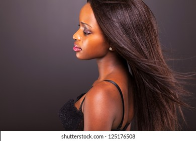 pretty thoughtful african american woman on black background