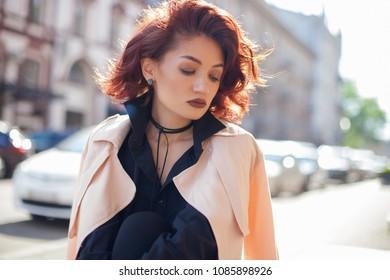 Pretty trendy girl posing at old european city