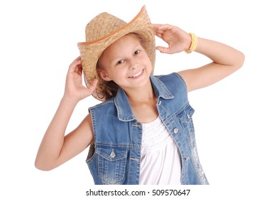 602673c2d65 Pretty twelve year old girls wearing a big floppy straw sun hat isolated on  white