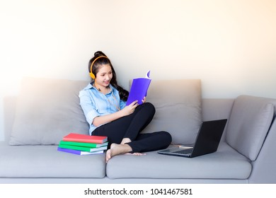 Pretty university student love listen lecture lesson of her teacher and studying textbook the same time. Charming beautiful woman is studious or erudite. Attractive girl feel happy and love studying