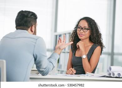 Pretty Vietnamese business lady conducting job interview