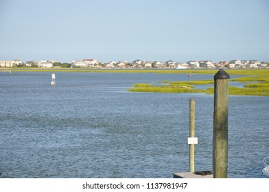 Pretty view of pristine Marshland with oceanfront development in background