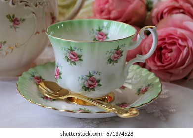 Pretty vintage mint green and pink rosebuds teacup and saucer with gold teaspoon - tea party