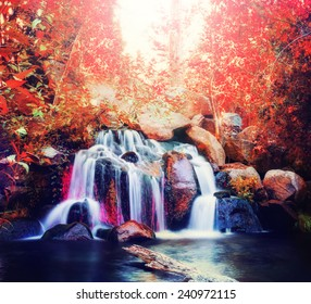 pretty waterfalls toned with a warm retro vintage instagram filter effect (slow shutterspeed for cascading water softening)