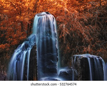 pretty waterfalls toned with a warm retro vintage instagram filter effect (slow shutter speed for cascading water softening)