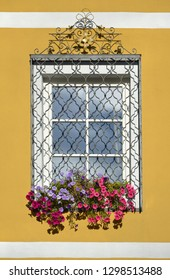 A pretty window with flowers in a house in Cavalese, Italy.