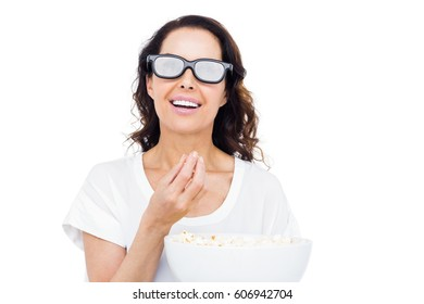 Pretty woman with 3D glasses eating popcorn over white background