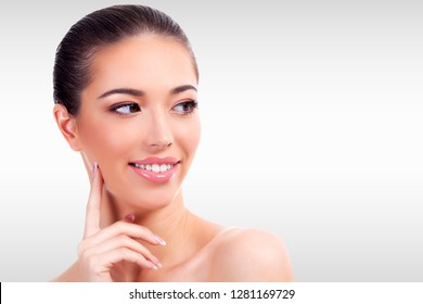 Pretty woman against a grey background with copyspace. Skin care concept
