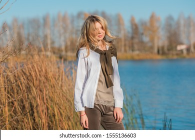 Pretty woman, American or European appearance, fashionable concept. Young lady, stylishly dressed at nature .Natural beauty
