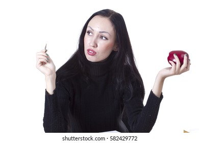 Pretty woman with an apple in his hand on a white background