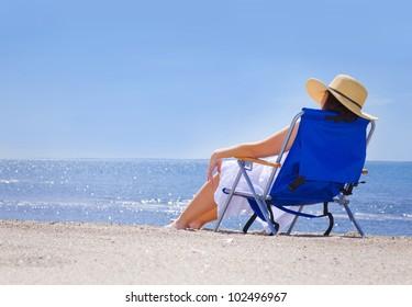Pretty woman at the beach in summer portrait