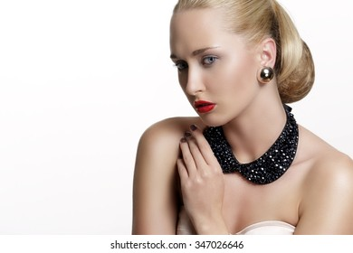 Pretty woman  and beautiful gold an silver jewelry on white