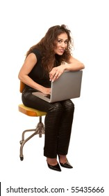 Pretty woman in black with computer seated on orange office chair