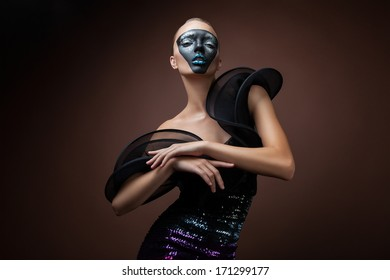 pretty woman in black dress with mask