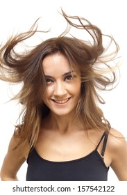 Pretty woman with black shirt and with her hair in the wind on white background