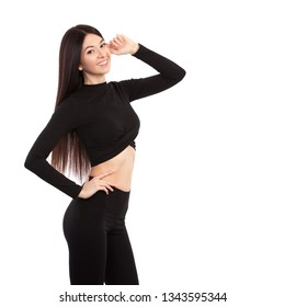 Pretty woman in black suit isolatd on white background with copy space. Close up of sporty and beautiful female body. Tanned brunette with long hair. Healthy lifestyle, dieting, fitness, weight loss