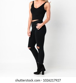 Pretty Woman in a Black Tank Top and Jeans - Full Length